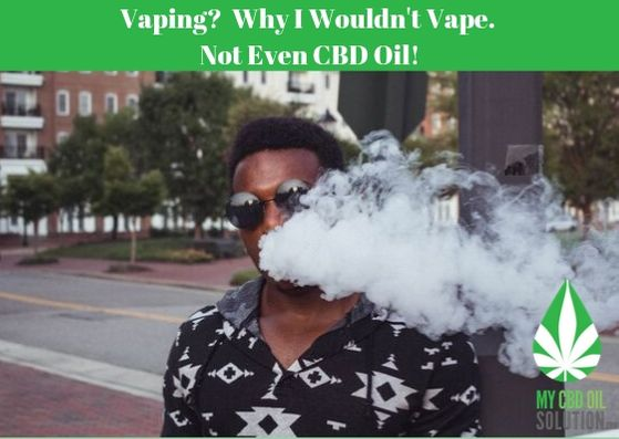 Man Vaping Blowing Smoke Around Face